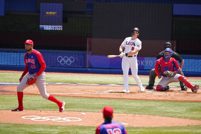 United States' Triston Casas (26) and Dominican Republic pitcher Denyi Reyes (41) watch his home run in the first inning of a baseball game at the 2020 Summer Olympics, Wednesday, Aug. 4, 2021, in Yokohama, Japan. (AP Photo/Sue Ogrocki)