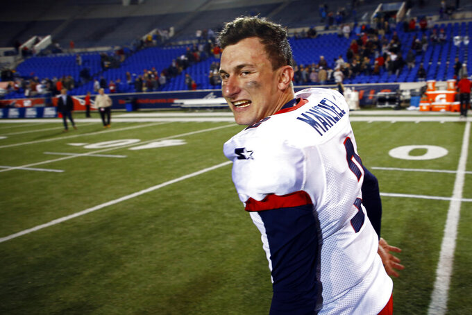 FILE - In this March 24, 2019, file photo, Memphis Express quarterback Johnny Manziel celebrates as he leaves the field after an AAF football game at Liberty Bowl Memorial Stadium in Memphis, Tenn. If you're really looking for something different: a fan-controlled football league is launching this weekend. It's sort of a video game meets pro wrestling meets arena football, allowing viewers to actually call plays for none other than Manziel. (AP Photo/Wade Payne, File)