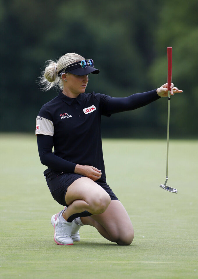 Charley Hull, of England, lines up her putt on the 16th green during the final round of the Meijer LPA Classic golf tournament, Sunday, June 20, 2021, in Grand Rapids, Mich. (AP Photo/Al Goldis)