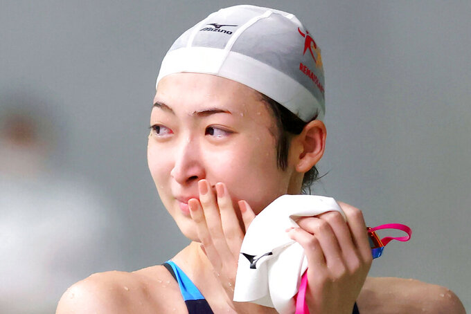 Japanese swim star Rikako Ikee reacts after a women's 50-meter freestyle at a local race meet, Saturday, Aug. 29, 2020, at Tokyo Tatsumi International Swimming Center in Tokyo. Ikee, who revealed in February last year she had leukemia, returned to competitive swimming on Saturday. The meet was organized by the Tokyo Swimming Association to give athletes a chance to compete following the cancellation of so many other meets this year due to the coronavirus pandemic.(Kyodo News via AP)