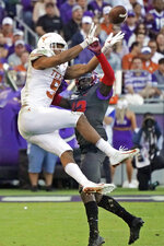 TCU cornerback Jeff Gladney (12) breaks up a pass intended for Texas wide receiver Collin Johnson (9) in the second half of an NCAA college football game in Fort Worth, Texas, Saturday, Oct. 26, 2019. (AP Photo/Louis DeLuca)