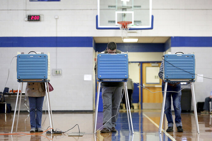 Voters cast ballots in the gym at York High Tuesday, Nov. 5, 2019. President Donald Trump is on voters' minds as Virginians decide whether Republicans or Democrats will control Virginia's legislature. (Rob Ostermaier/The Daily Press via AP)