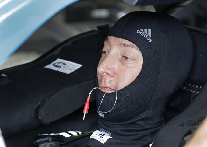 Kyle Busch waits in his car before practice for Saturday's NASCAR All-Star Cup series auto race at Charlotte Motor Speedway in Concord, N.C., Friday, May 17, 2019. (AP Photo/Chuck Burton)