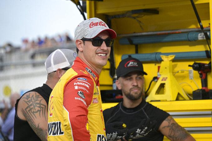 Driver Joey Logano chats with crew members on pit road before a NASCAR Cup Series auto race at Daytona International Speedway, Saturday, Aug. 28, 2021, in Daytona Beach, Fla. (AP Photo/Phelan M. Ebenhack)