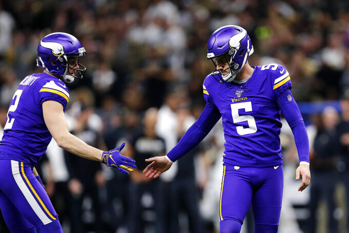 Minnesota Vikings holder Britton Colquitt (2) congratulates kicker Dan Bailey (5) on a field goal in the first half of an NFL wild-card playoff football game against the New Orleans Saints, Sunday, Jan. 5, 2020, in New Orleans. (AP Photo/Brett Duke)