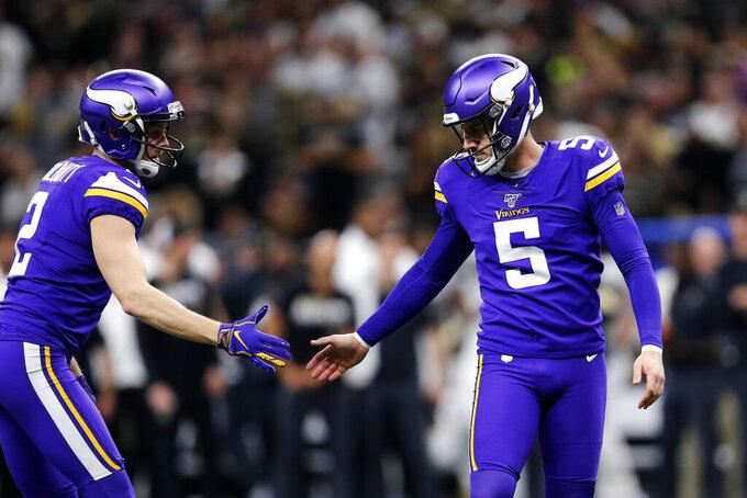Minnesota Vikings holder Britton Colquitt (2) congratulates kicker Dan Bailey (5) on a field goal in the first half of an NFL wild-card playoff football game against the New Orleans Saints, Sunday, Jan. 5, 2020, in New Orleans. (AP Photo/Brett Duke)