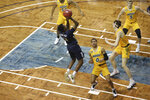 Oral Roberts guard Kareem Thompson (2) shoots against North Dakota State during the first half of an NCAA college basketball game for the Summit League men's tournament championship Tuesday, March 9, 2021, in Sioux Falls, S.D. (AP Photo/Josh Jurgens)