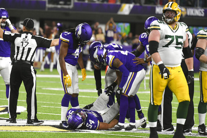 Minnesota Vikings middle linebacker Eric Kendricks (54) lies on the field after recovering a fumble during the first half of the team's NFL football game against the Green Bay Packers, Monday, Dec. 23, 2019, in Minneapolis. (AP Photo/Craig Lassig)
