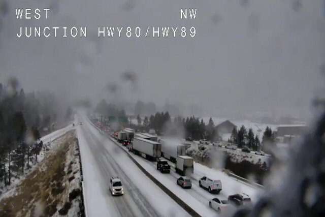 In this still image taken from a Caltrans remote video traffic camera, traffic is stopped along Interstate 80 because of multiple spinouts, Tuesday, Nov. 26, 2019, in Truckee, Calif. Northern California and southern Oregon residents are bracing for a