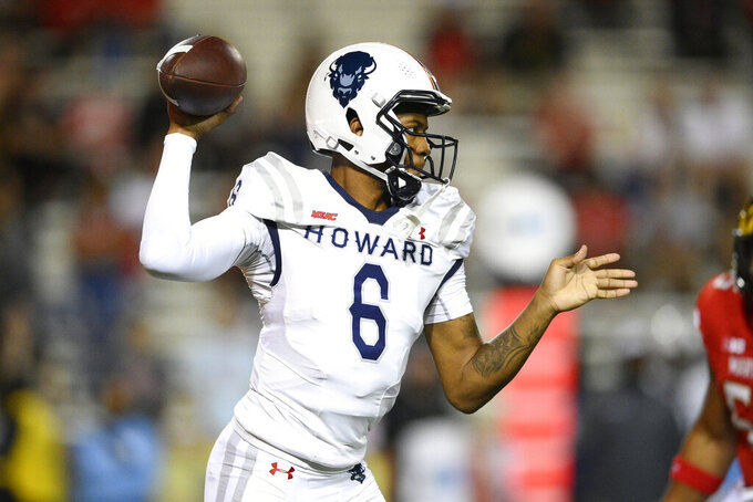 Howard quarterback Quinton Williams (6) looks to pass during the first half of an NCAA college football game against Maryland, Saturday, Sept. 11, 2021, in College Park, Md. (AP Photo/Nick Wass)