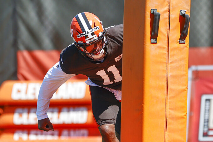 Cleveland Browns wide receiver Donovan Peoples-Jones runs through a tackling drill during practice at the NFL football team's training facility Wednesday, Aug. 19, 2020, in Berea, Ohio. (AP Photo/Ron Schwane)