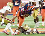 Syracuse running back Cooper Lutz (24) carries the ball against Boston College during an NCAA college football game, Saturday, Nov. 7, 2020, at the Carrier Dome in Syracuse, N.Y. (Dennis Nett/The Post-Standard via AP)