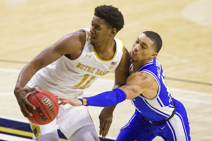 Notre Dame's Juwan Durham (11) gets pressure from Duke's Jordan Goldwire during the second half of an NCAA college basketball game Wednesday, Dec. 16, 2020, in South Bend, Ind. Duke won 75-65. (AP Photo/Robert Franklin)