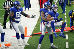 New York Giants' Sterling Shepard (87), right, celebrates his touchdown during the first half of an NFL football game against the Dallas Cowboys, Sunday, Jan. 3, 2021, in East Rutherford, N.J. (AP Photo/Corey Sipkin)