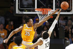 Tennessee guard Yves Pons (35) blocks a shot by Vanderbilt forward Matthew Moyer (13) during the first half of an NCAA college basketball game Saturday, Jan. 18, 2020, in Nashville, Tenn. (AP Photo/Mark Humphrey)