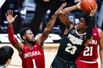 Purdue guard Jaden Ivey (23) shoots over Indiana guard Al Durham (1) during the second half of an NCAA college basketball game in West Lafayette, Ind., Saturday, March 6, 2021.  (AP Photo/Michael Conroy)