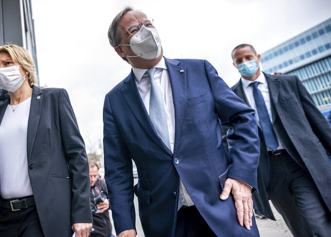 Armin Laschet, CDU federal chairman and minister president of North Rhine-Westphalia, arrives at the CDU presidium meeting in front of party headquarters in Berlin, Germany, Monday, April 12, 2021. (Michael Kappeler/dpa via AP)