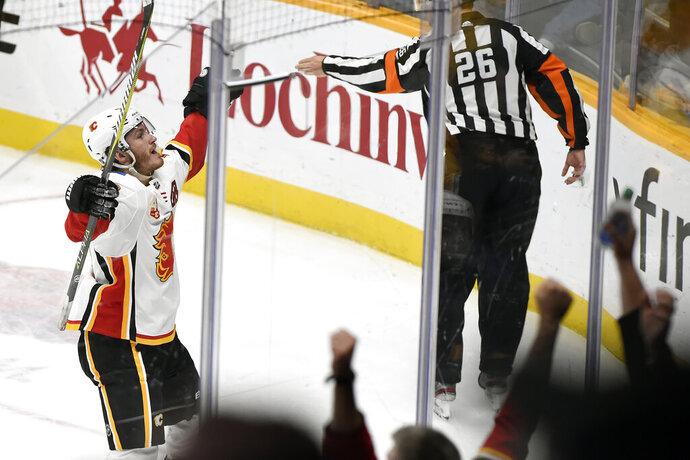 Calgary Flames left wing Matthew Tkachuk (19) celebrates after scoring against the Nashville Predators in overtime in an NHL hockey game Thursday, Oct. 31, 2019, in Nashville, Tenn. The Flames won 6-5. (AP Photo/Mark Zaleski)