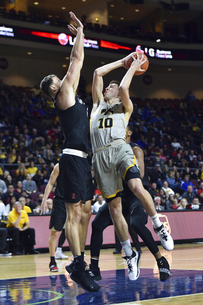 Iowa guard Joe Wieskamp (10) shoots against San Diego State forward Yanni Wetzell (5) during the second half of an NCAA college basketball game Friday, Nov. 29, 2019, in Las Vegas. (AP Photo/David Becker)