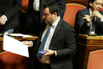 Opposition populist leader Matteo Salvini attends the debate at the Italian Senate on whether to allow him to be prosecuted – as he demands to be -- for alleging holding migrants hostage for days aboard coast guard ship Gregoretti instead of letting them immediately disembark in Sicily, while he was interior minister. Salvini says being on trial for alleged kidnapping is tantamount to defending his country from  illegal migrants he blames for crime and for subtracting jobs from Italians. (AP Photo/Andrew Medichini)