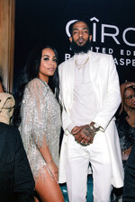 "This Feb. 10, 2019 photo released by Atlantic Records shows Lauren London, left, and Nipsey Hussle at the Ciroc After the Awards party at Avenue in Los Angeles. Hussle, who was shot and killed outside of his clothing store in Los Angeles on March 31, 2019, is nominated for three Grammy Awards, His song ""Racks In the Midldle is up for best rap performance and best rap song, while ""Higher,"" a collaboration with DJ Khaled and John Legend that one of the last songs Hussle recorded, is nominated for best rap/sung performance. (Jennifer Johnson for Combs Enterprises/Atlantic Records via AP)"