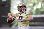 FILE - In this Aug. 5, 2019, file photo, Washington quarterback Jake Haener readies a throw during an NCAA football practice in Seattle. The Huskies could give both Georgia transfer Jacob Eason and Haener snaps in the opener, but would likely want a starter moving forward beginning with Week 2 and a challenging conference opener against California. (AP Photo/Elaine Thompson, File)