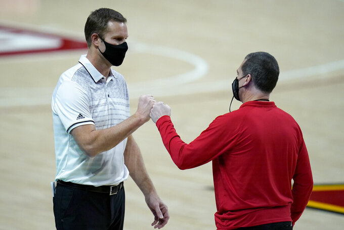 Nebraska head coach Fred Hoiberg, left, and Maryland head coach Mark Turgeon talk after an NCAA college basketball game, Wednesday, Feb. 17, 2021, in College Park, Md. Maryland won 79-71. (AP Photo/Julio Cortez)
