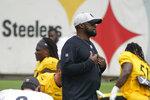 Pittsburgh Steelers head coach Mike Tomlin walks among his players as they warm up for an NFL football practice, Monday, Aug. 9, 2021, in Pittsburgh. (AP Photo/Keith Srakocic)
