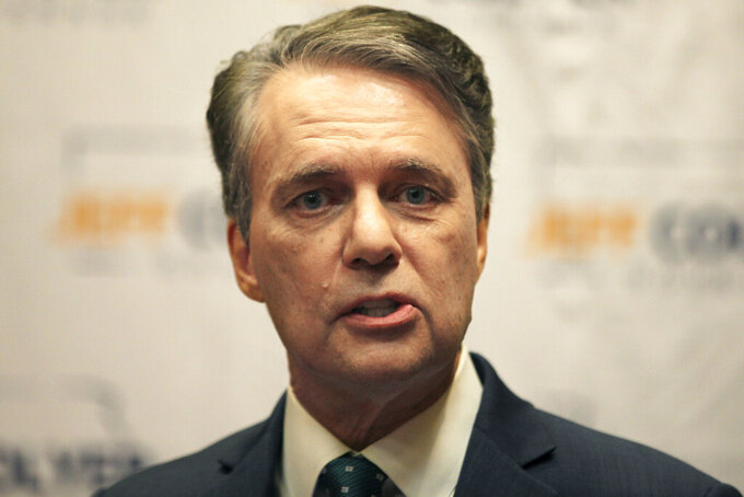 FILE - In this April 19, 2021 file photo, former Kansas Gov. Jeff Colyer formally launches his campaign for governor in 2022 in Topeka, Kan.  Colyer announced Monday, Aug. 30 that he is dropping out of the 2022 race for governor after being diagnosed with prostate cancer. Colyer was governor for a little less than a year, elevated from lieutenant governor in January 2018 when GOP Gov. Sam Brownback resigned to become U.S. ambassador at large for international religious freedom.  (AP Photo/John Hanna, File)