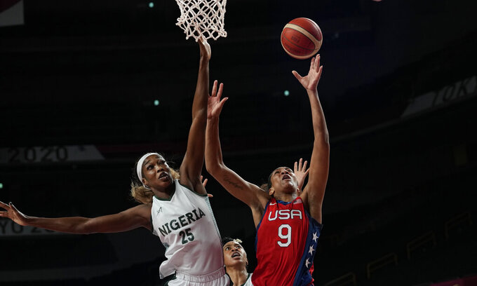 United States' A'Ja Wilson (9), right, shoots over Nigeria's Victoria Macaulay (25) during women's basketball preliminary round game at the 2020 Summer Olympics, Tuesday, July 27, 2021, in Saitama, Japan. (AP Photo/Eric Gay)