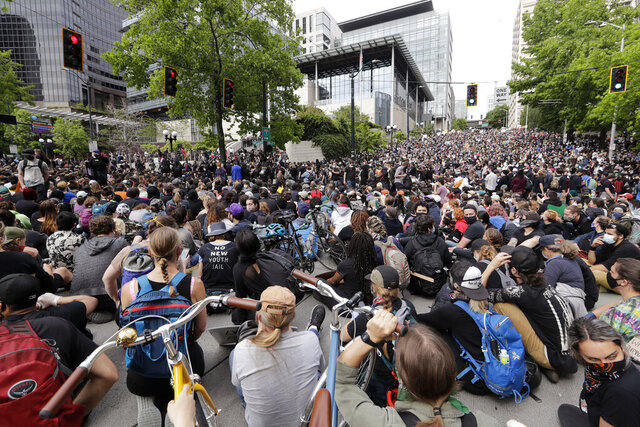 Peaceful protesters fill the intersection in front of Seattle City Hall Wednesday, June 3, 2020, in Seattle, following protests over the death of George Floyd, a black man who was in police custody in Minneapolis. (AP Photo/Elaine Thompson)