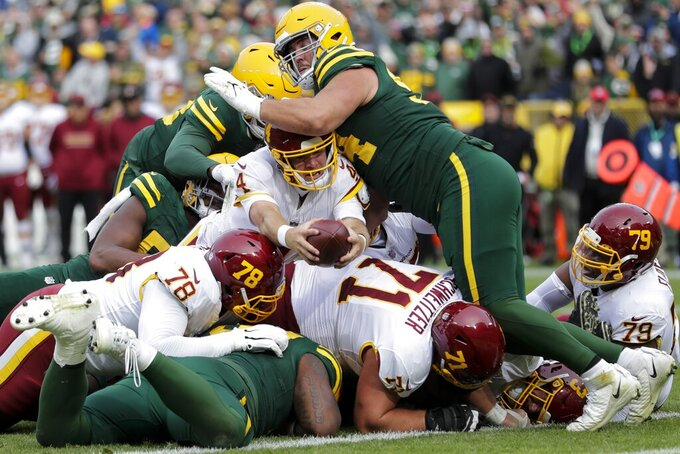 Washington Football Team's Taylor Heinicke is stopped at the goal line on fourth down during the second half of an NFL football game against the Green Bay Packers Sunday, Oct. 24, 2021, in Green Bay, Wis. (AP Photo/Aaron Gash)