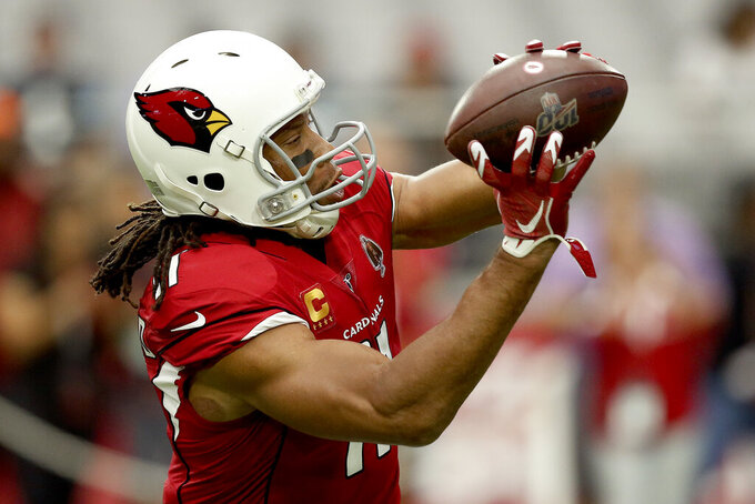 Arizona Cardinals wide receiver Larry Fitzgerald (11) warms up prior to an NFL football game against the Carolina Panthers, Sunday, Sept. 22, 2019, in Glendale, Ariz. (AP Photo/Ross D. Franklin)