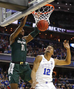 Michigan State forward Aaron Henry (11) scores on Duke forward Javin DeLaurier (12) during the second half of an NCAA men's East Regional final college basketball game in Washington, Sunday, March 31, 2019. (AP Photo/Patrick Semansky)