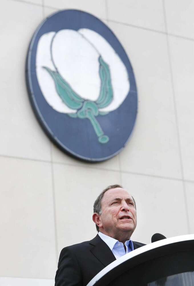 NHL commissioner Gary Bettman speaks from the podium during a news conference outside the Cotton Bowl in Dallas, Wednesday, March 20, 2019. Bettman was on hand to announce the NHL Winter Classic hockey game between the Nashville Predators and the Dallas Stars to be played Jan. 1, 2020, at the Cotton Bowl in Dallas. (AP Photo/LM Otero)