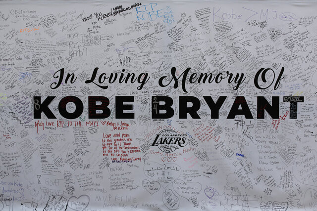 File-This Jan. 28, 2020, file photo shows a remembrance board at a memorial for Kobe Bryant near Staples Center in Los Angeles. Bryant, the 18-time NBA All-Star who won five championships and became one of the greatest basketball players of his generation during a 20-year career with the Los Angeles Lakers, died in a helicopter crash Sunday. (AP Photo/Ringo H.W. Chiu, File)