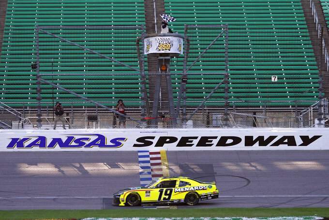Brandon Jones takes the checkered flag as he wins a NASCAR Xfinity Series auto race at Kansas Speedway in Kansas City, Kan., Saturday, July 25, 2020. (AP Photo/Charlie Riedel)