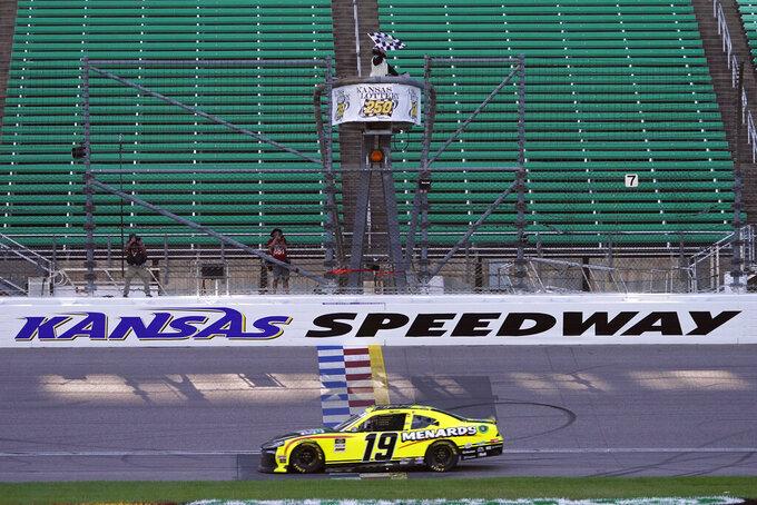 Brandon Jones takes the checkered flag as he wins a NASCAR Xfinity Series auto race at Kansas Speedway in Kansas City, Kan., Saturday, July 25, 2020. (AP Photo/Charlie Riedel)