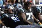Carolina Panthers defensive tackle Vernon Butler, left and defensive tackle Kyle Love (77) sit on the bench during the second half of an NFL football game against the San Francisco 49ers in Santa Clara, Calif., Sunday, Oct. 27, 2019. San Francisco won the game 51-13. (AP Photo/Ben Margot)