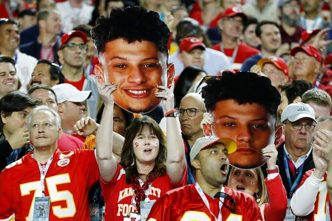 Kansas City Chiefs fans cheer during the first half of the NFL Super Bowl 54 football game against the San Francisco 49ers Sunday, Feb. 2, 2020, in Miami Gardens, Fla. (AP Photo/Mark Humphrey)
