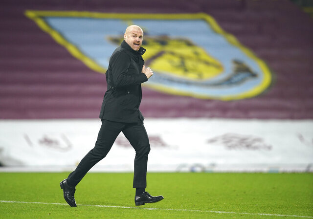 Burnley manager Sean Dyche runs to the touchline before the second half during the English Premier League soccer match between Burnley and Sheffield United at the Turf Moor stadium in Burnley, England, Tuesday, Dec. 29, 2020. (Dave Thompson/Pool via AP)
