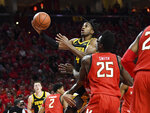 Iowa guard Bakari Evelyn (4) goes to the basket for a layup during the first half of the team's NCAA college basketball game against Maryland on Thursday, Jan. 30, 2020, in College Park, Md. (AP Photo/Terrance Williams)