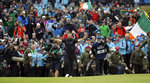 Ireland's Shane Lowry walks arms outstretched on the 18th green on his way to winning the British Open Golf Championships at Royal Portrush in Northern Ireland, Sunday, July 21, 2019.(AP Photo/Matt Dunham)