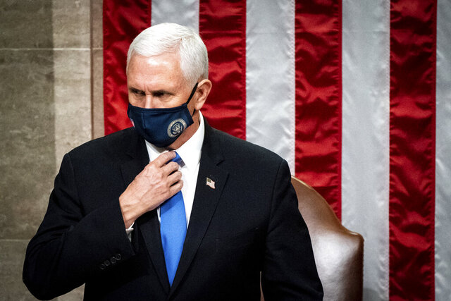 Vice President Mike Pence officiates as a joint session of the House and Senate reconvenes to confirm the Electoral College votes at the Capitol, Wednesday, Jan 6, 2021. (Erin Schaff/The New York Times via AP, Pool)