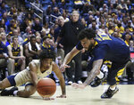 Akron's Greg Tribble (2) and West Virginia's Jermaine Haley (10) go for the ball during the second half of an NCAA college basketball game, Friday, Nov. 8, 2019, in Morgantown, W.Va. (AP Photo/Kathleen Batten)