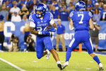 Kentucky running back Chris Rodriguez Jr. (24) carries the ball during the second half of the team's NCAA college football game against Missouri in Lexington, Ky., Saturday, Sept. 11, 2021. (AP Photo/Michael Clubb)