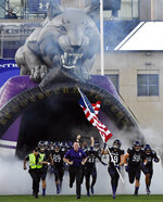 FILE - In this Sept. 15, 2018, file photo, Northwestern head coach Pat Fitzgerald leads his his team onto the field before an NCAA college football game against Akron in Evanston, Ill. Northwestern can clinch the Big Ten West championship and its first appearance in the conference title game by winning two of its final three games.  (AP Photo/Matt Marton, File