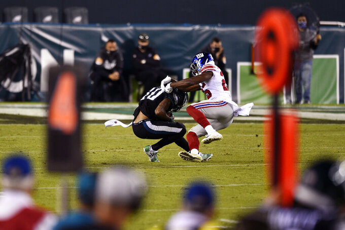 Philadelphia Eagles' DeSean Jackson (10) is tackled by New York Giants' Corey Ballentine (25) during the second half of an NFL football game, Thursday, Oct. 22, 2020, in Philadelphia. (AP Photo/Derik Hamilton)