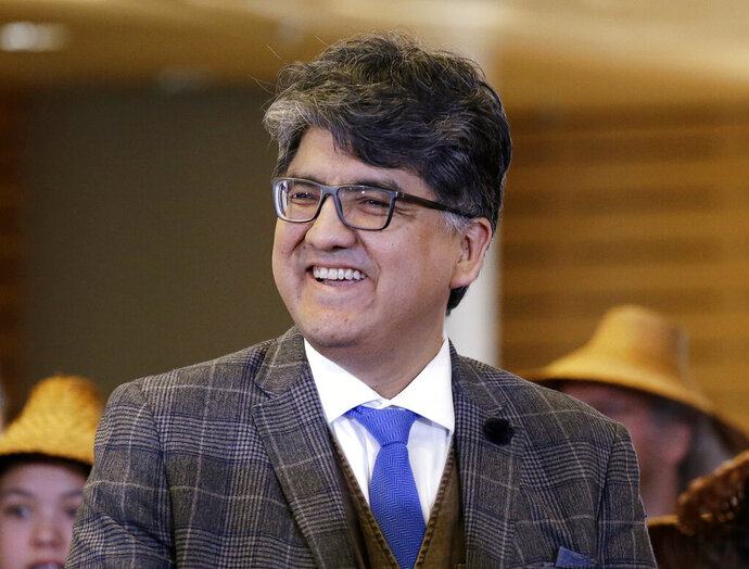 """FILE - In this Oct. 10, 2016 file photo, author and filmmaker Sherman Alexie appears at a celebration of Indigenous Peoples' Day at Seattle's City Hall.  Alexie is included in a list of authors who wrote books that were among the 100 most subjected to censorship efforts over the past decade, as compiled by the American Library Association. Alexie's prize-winning """"The Absolutely True Diary of a Part-Time Indian"""" came in at No. 1.  (AP Photo/Elaine Thompson, File)"""