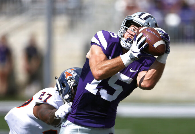 Kansas State wide receiver Zach Reuter (15) catches a 38-yard pass as UTSA cornerback Teddrick McGhee (27) defends during the first quarter of a college football game in Manhattan, Kan., Saturday, Sept. 15, 2018. (AP Photo/Colin E. Braley)